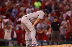 Los Angeles Dodgers starting pitcher Clayton Kershaw looks to the ground as St. Louis Cardinals Matt Adams circles the bases after hitting a three run home run in the seventh inning in Game 4 of the NLDS at Busch Stadium in St. Louis on October 7, 2014. UPI/Bill Greenblatt